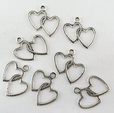 Lot de 12 breloques double coeur en métal argenté vieilli ,perles,fimo-bc106