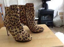 Leopardo Pony. botas talla 5