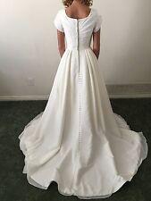 Brand new size 2 wedding dress with POCKETS!