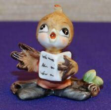 Miniature Josef Originals Bisque Singing Bird On A Branch Holding A Song Book