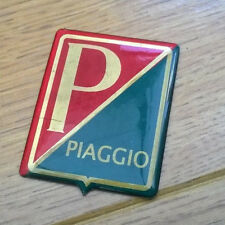 VESPA /PIAGGIO HORNCAST BADGE. RED/GREEN STICK ON TYPE .BRAND NEW