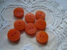 8 Orange Ridged 1940's  Plastic Buttons