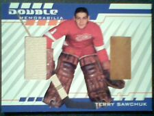 TERRY SAWCHUK  AUTHENTIC DUAL PIECES OF GAME-USED JERSEY AND PADS /50   SP