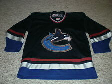 Vancouver Canucks CCM replica jersey youth kids L / XL dark blue new logo