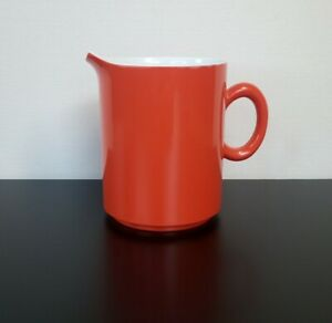 """Vintage Orange Melamine Small Jug.  60s 3.5"""" tall x 2.75"""" some scratches"""