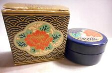 Avon Oriental Classic Lip Gloss in a round container with flowers,coral/peach???