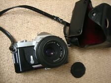 Nikon SLR camera (late 1960s) with detachable lens, leather cover, and hard case