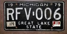 1979 MICHIGAN LICENSE PLATE RFV-006 BLACK & WHITE W 1983 APRIL  STICKER TAGS