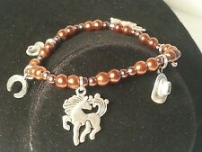 Silver Tone Horse, Cowboy Hat, & Horseshoe Brown Glass Bead Stretch Bracelet