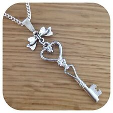 Alice in Wonderland Bow Key charm necklace
