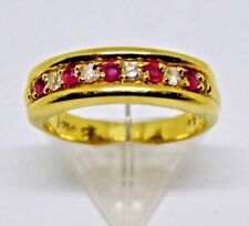 Diamond/Ruby yellow gold nine stone ring. Has .750 stamped on the in side