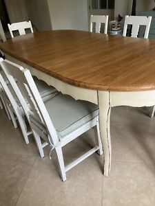 Beautiful French style solid wood dining table. Wood top, painted curved legs.
