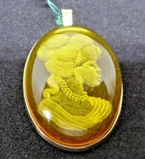 Amber pendant oval translucent intaglio  set with plain 9ct gold surround