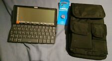 PSION SERIES 5 touchscreen pocket computer with unique strap case.