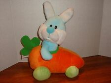 "Easter Bunny Rabbit riding a Carrot Car by Walmart, Inc., 10"" long x 12"" tall"