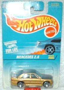 Hot Wheels 1997 #605 Mercedes 2.6 gold,black int,lace wheels,excellent card