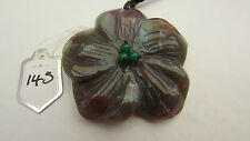 A SUPERB CARVED FLOWER AGATE PENDANT ON A WAXED CORD NECKLACE.  (145)