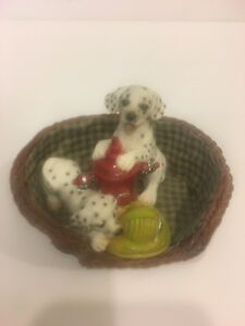 Vintage living stone dalmatians dog in basket fire hydrant & helmet figurine.