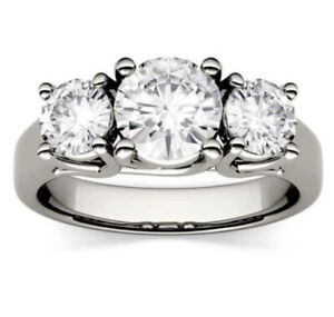 Beautiful Charles & Colvard 2.00CTW Round Moissanite Trellis Three Stone Ring