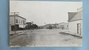 1909 Edgemont South Dakota Main Street Real Photo Post Card-Railroad & Cow Town
