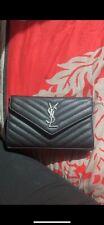 Sac en cuir noir Yves Saint Laurent, il est neuf. Je n'ai plus la facture