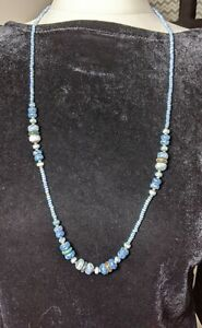 Delicate beaded necklace in soft blue colours 39cm long.  tiny beads flat beads
