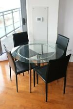Dining table with round clear glass and metal legs