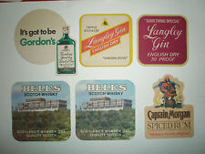 SIX BEERMATS FROM THE LATE 1970'S LANGLEY & GORDON'S GIN, BELLS &CAPTAIN MORGAN