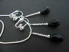 A SILVER PLATED BLACK CRYSTAL TEARDROP  NECKLACE AND CLIP ON EARRING SET. NEW.