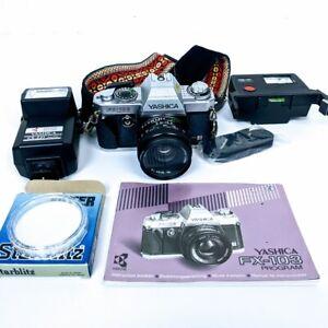 Vtg Yashica Kyocera FX-103 SLR Camera with 2 Flashes, Strap, Manual & Filter