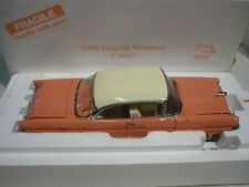 A Danbury mint of a scale model of a 1956 Lincoln premiere 2 door coupe,  Boxed
