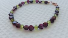 GARNET, PERIDOT AND ROSE GOLD PLATED STERLING SILVER BRACELET.