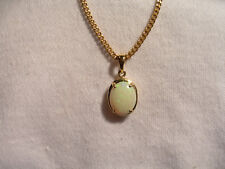 ( Lot 705 ) 14k Gold Pendant with pale Green Coober Pedy Opal in a claw setting.