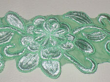 """2 yards in 2 3/4"""" width in emeral green color poly, thread and organza trim"""
