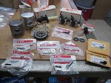 NOS Suzuki OEM Petcocks Gear Bolt 63mm & 67mm Pistons Etc Parts Lot