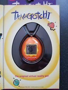 Original Bandai 1997 Tamagotchi gen 1 - orange - new in box - english version
