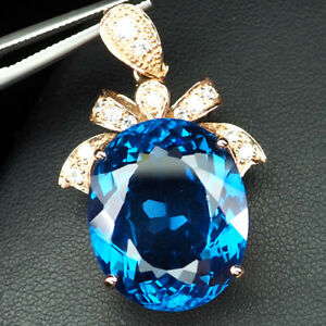 TOPAZ INTENSE SWISS BLUE OVAL 41.80 CT. 925 STERLING SILVER ROSE GOLD PENDANT
