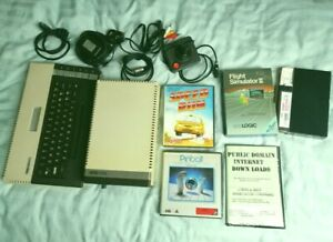 Atari 800XL 8-bit computer - 1050 disk drive.Cables,PSUs, Joystick & boxed games