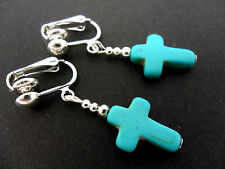 A PAIR OF TURQUOISE BLUE  SILVER PLATED CROSS CLIP ON   EARRINGS. NEW.