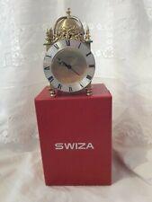 An 8 Day Swiza Alarm Lantern clock with original box.