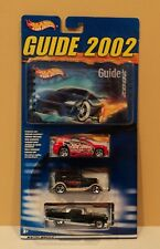 HOT WHEELS - 2002 Guide with THREE Hot Wheels cars - includes one EXCLUSIVE car