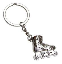 Porte-clés, bijou de sac roller skate, patin a roulette en acier chromé.