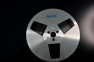 "AKAI 7"" metal take up reel with tape"