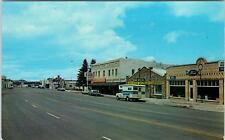 SPRINGERVILLE, AZ Arizona   Street Scene FORD DEALER Rexall  c1960s    Postcard