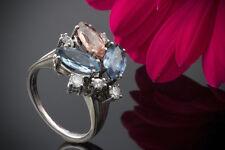 Schmuck Verspielter Ring mit Topas Aquamarin Diamanten in 750 Weißgold 18 Karat