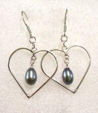 Orecchini di bigiotteria perle nere a cuore