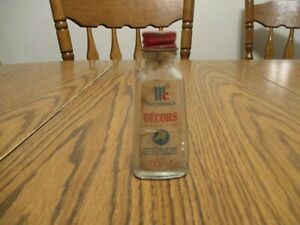 ANTIQUE MCCORMICKS SILVER DECORS GLASS BOTTLE WITH LID