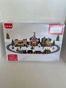 Holiday Time Village Train Set New in the Box 12 Piece Set.