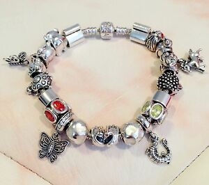 20cm Genuine 925ALE Pandora Bracelet + 20 Pandora Charms + 1 Cat 925 Charm.