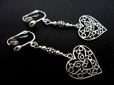 A PAIR OF TIBETAN SILVER HEART DANGLY CLIP ON EARRINGS. NEW.